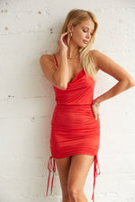 Red mini dress with side cinched tie details.