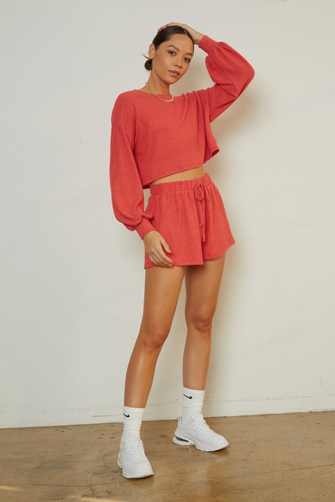 Red loungewear set with drawstring shorts and crop top.
