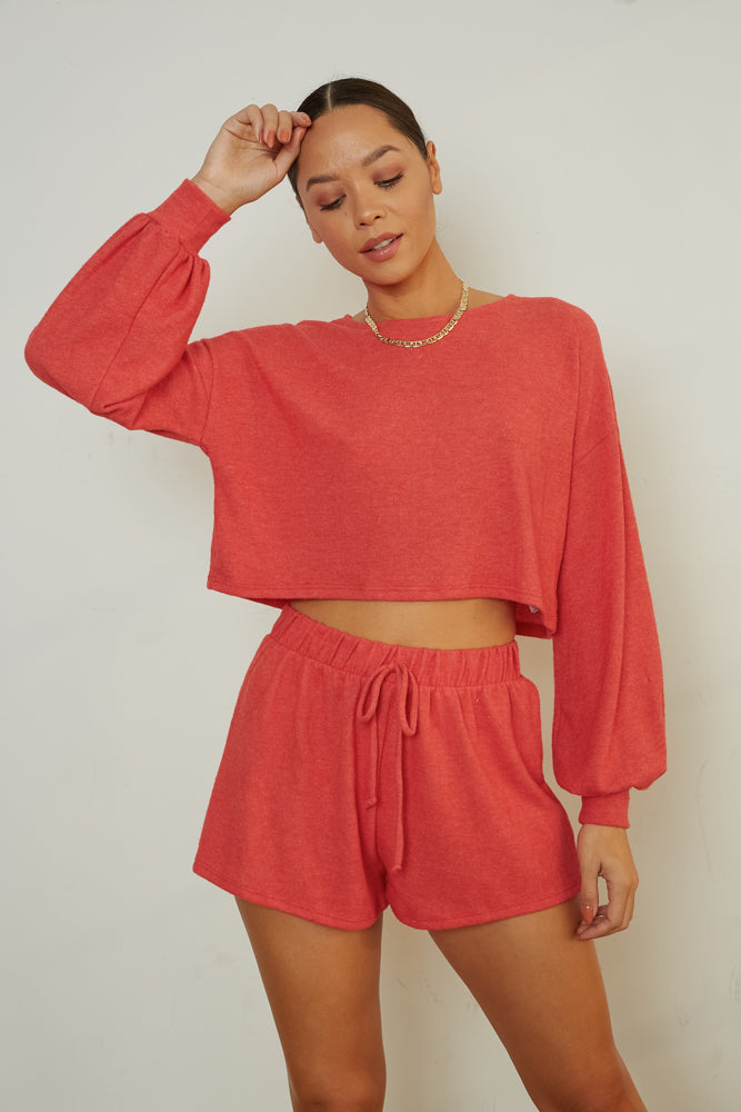 Red sweater top with matching shorts.