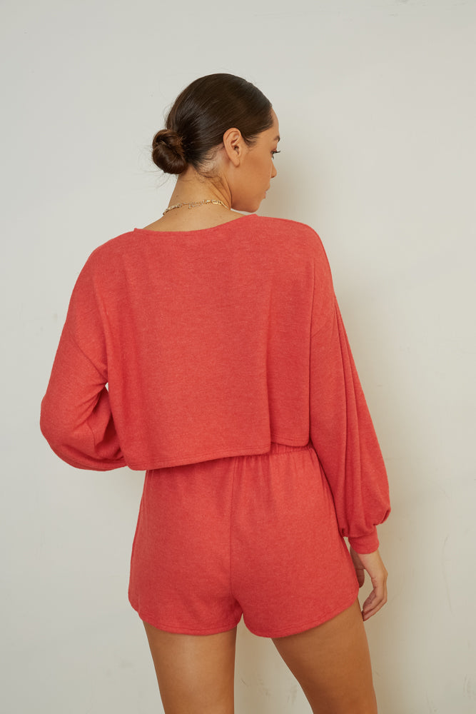 The back of this set shows of the boxy crop top and relaxed fit shorts.