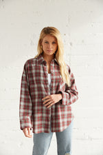 Burgundy flannel with button up front.