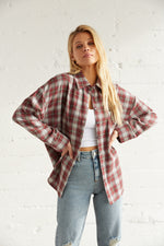 Oversized flannel shirt with long sleeves.