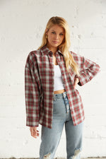 Oversized flannel in burgundy plaid design.