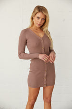 Ribbed knit sweater dress with V neckline.