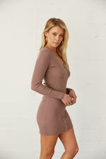 The side of this dress is fitted with long sleeves.