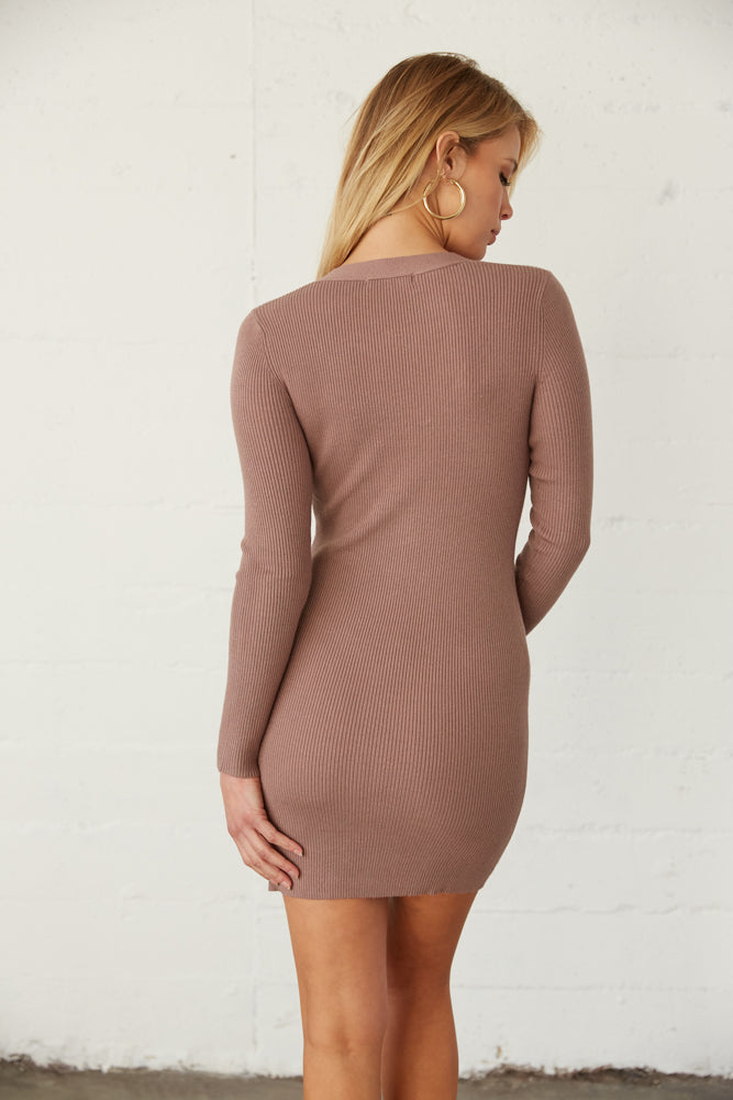 The back of this dress is fitted for the perfect fit.