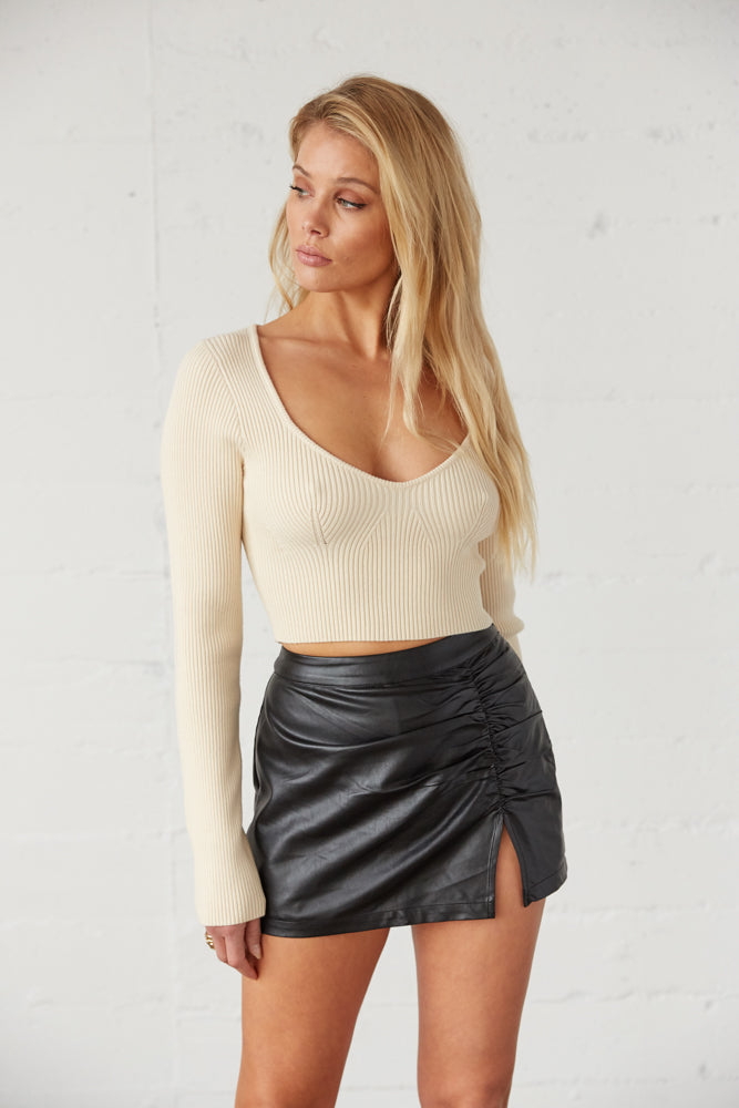 Beige thick ribbed crop top.