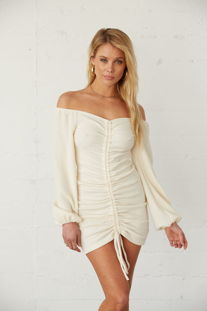 Off white cinched dress with adjustable tie detail.