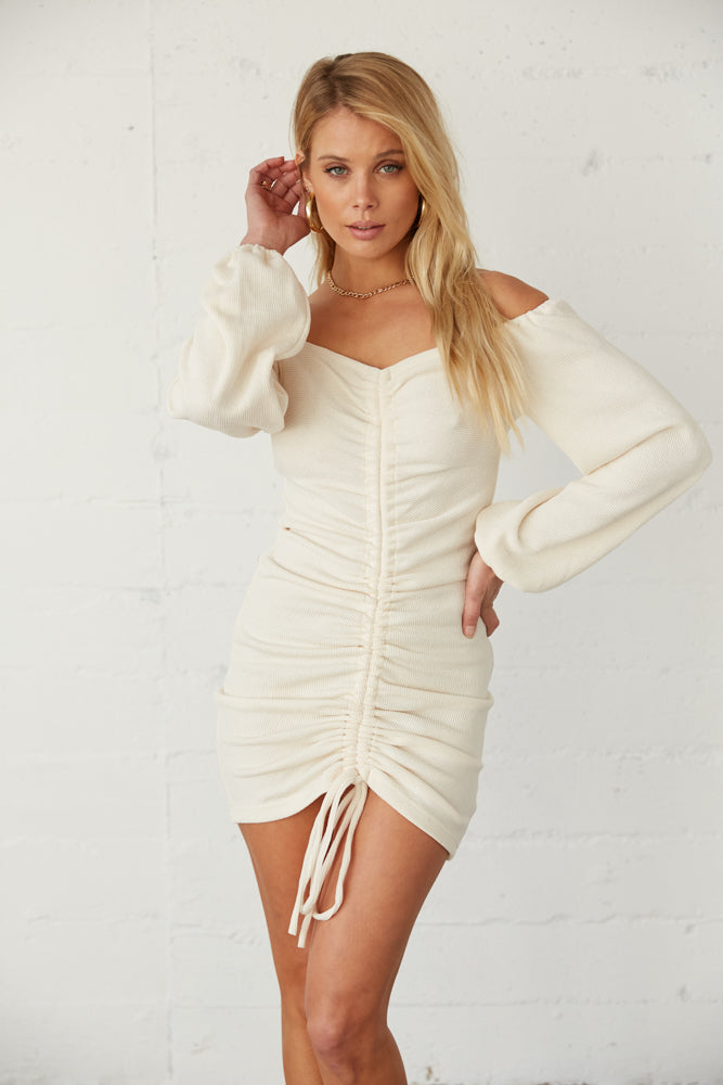 White off shoulder dress with adjustable cinched tie detail.