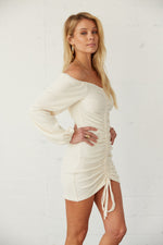 Off shoulder dress with long billowy sleeves.