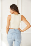 The back of this top is ribbed and cropped.