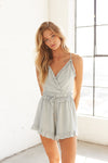 Light blue ruffle wrap romper.
