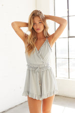 Tie detail on ruffle wrap romper.