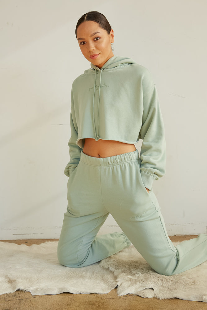 Green crop sweater with matching sweatpants.