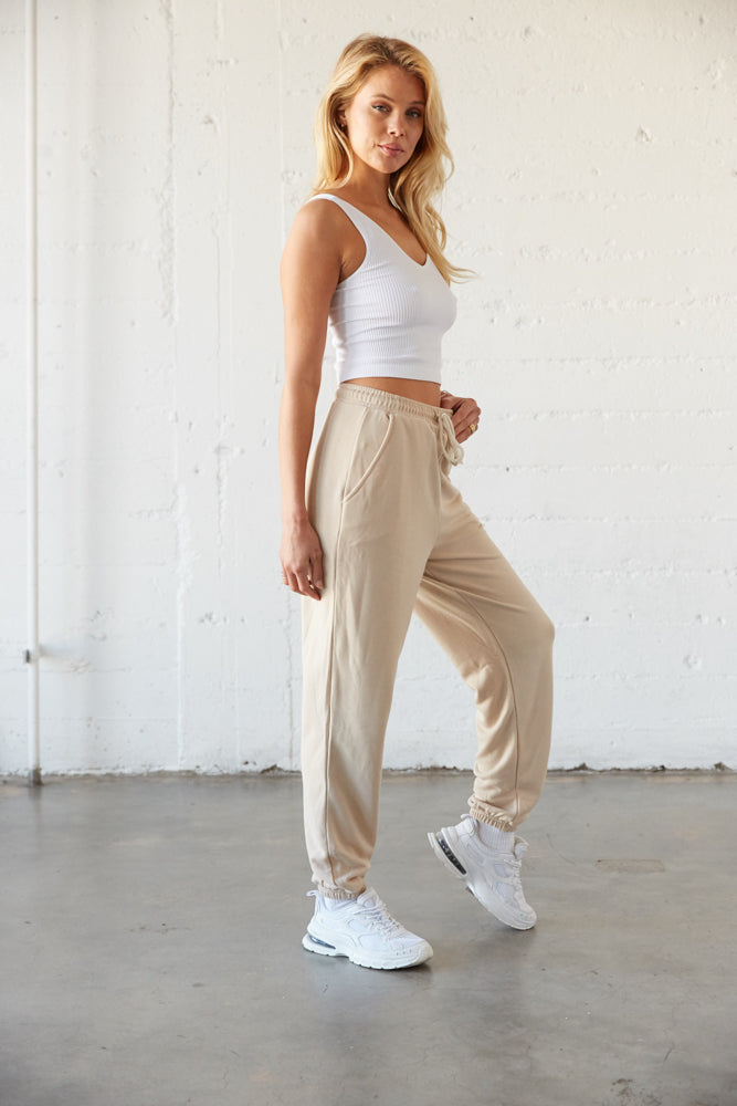 The side of these joggers have pockets and an elastic hem.