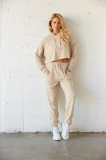 Matching loungewear set with a crop hoodie and joggers.