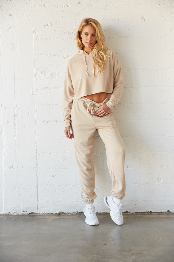 Tan cropped hoodie with matching high waisted joggers.