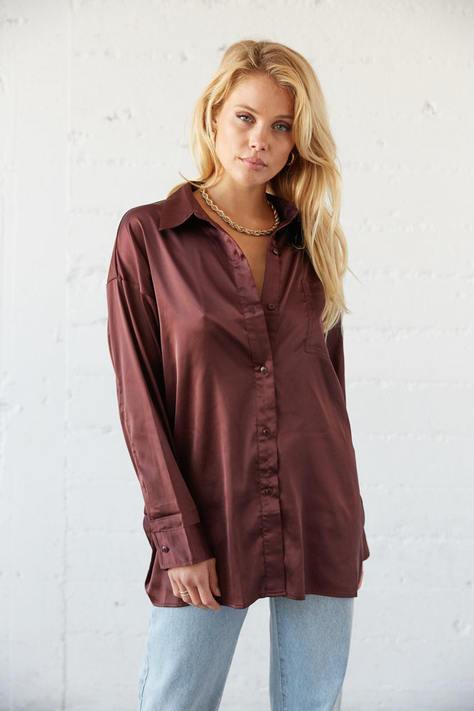 This button up shirt can be worn opened with a V neckline.