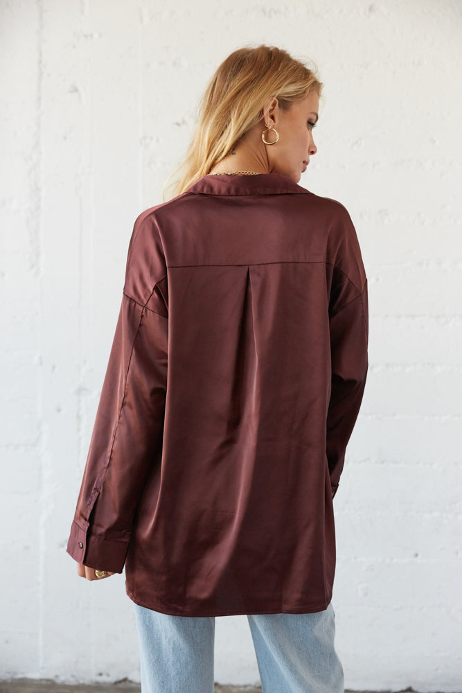 The back of this shirt is relaxed with a pleated detail.
