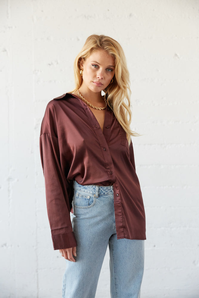 Style this top worn half tucked in.