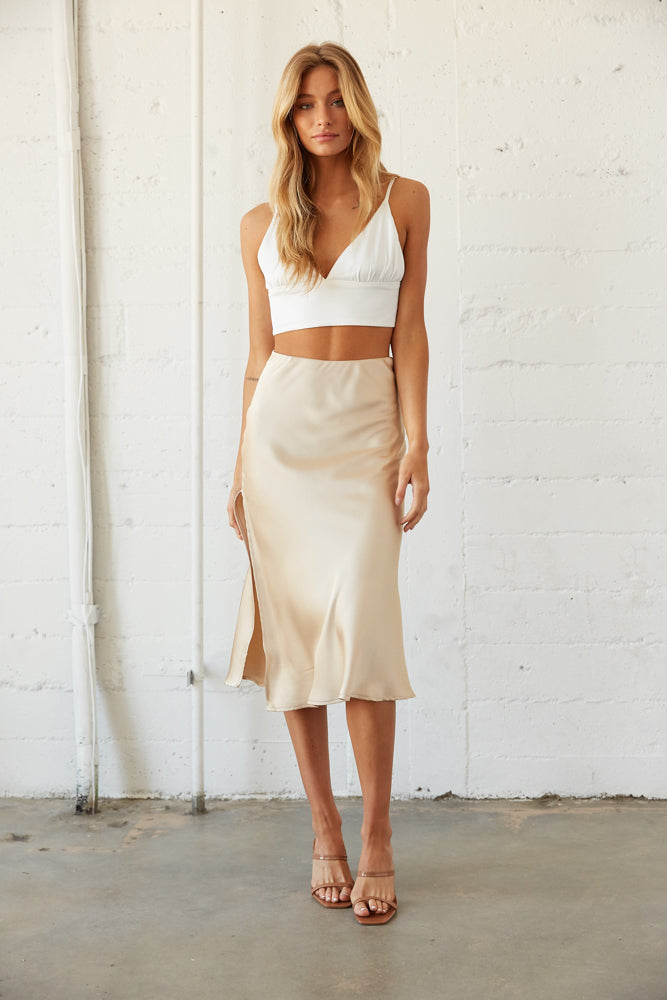 Satin midi skirt with white crop tank top.