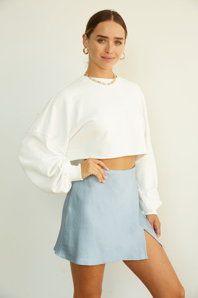 Steel blue satin mini skirt with side slit detail.
