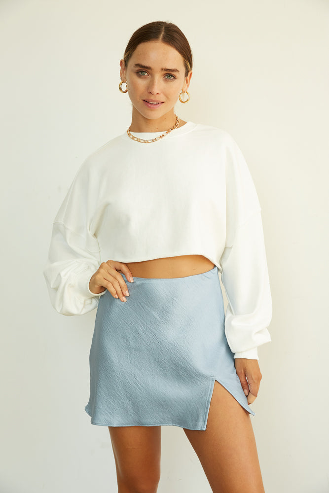 Satin mini skirt with side slit detail.