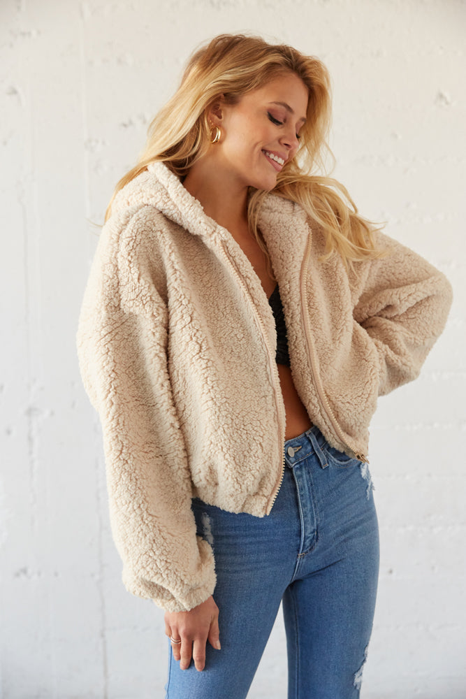 Teddy crop jacket with front zipper closure.