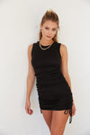 Black cinched mini dress with side tie details.