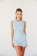 Blue cinched mini dress with side tie details.