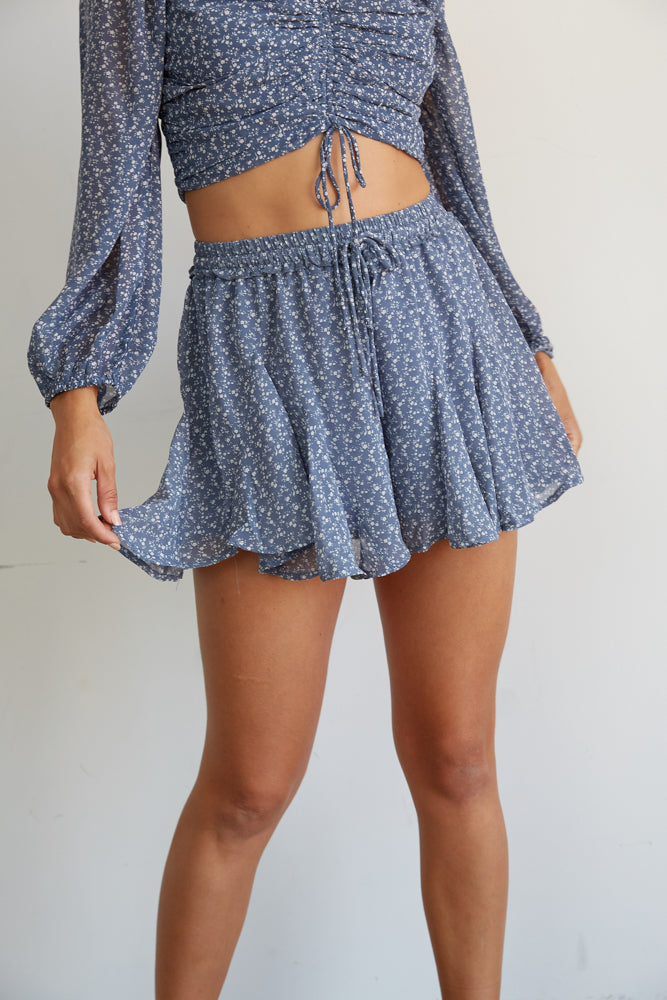 These dusty blue shorts have a white floral print.
