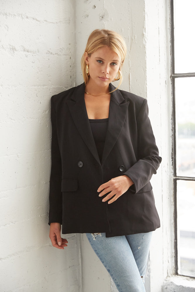 Black blazer with button up front.