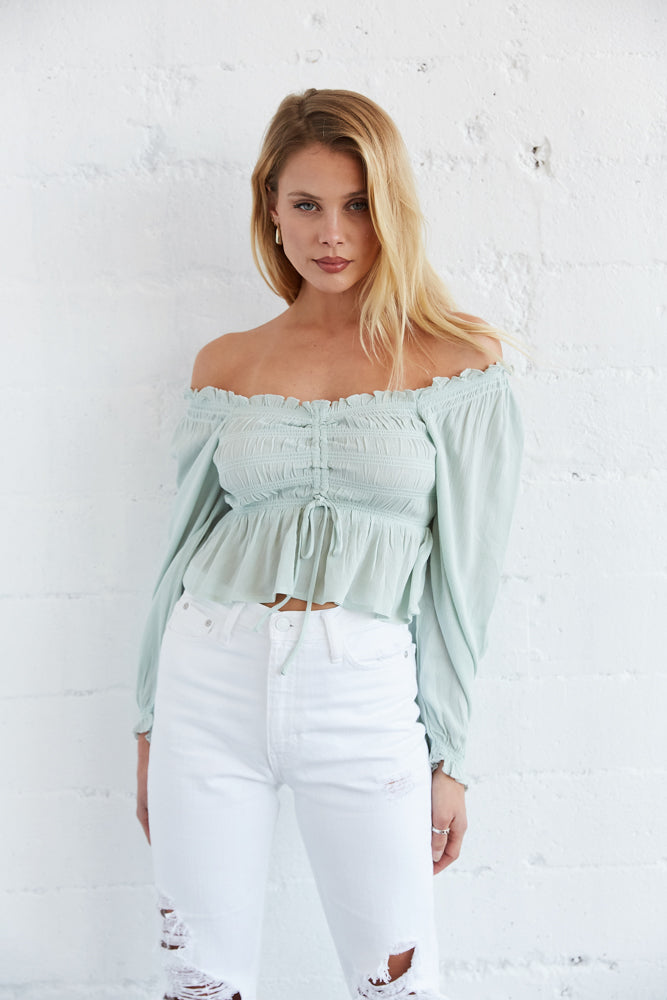 Mint green smocked ruffle crop top.