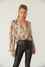 Snakeskin ruffle crop top with long sleeves.