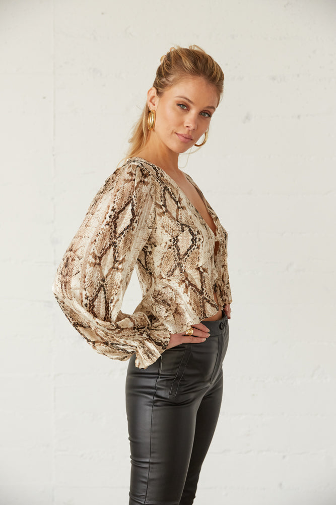 The side of this top has long sleeves and a ruffled trim.