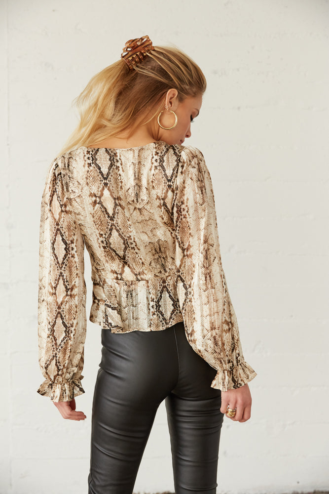 The back of this top has long sleeves and a relaxed fit.