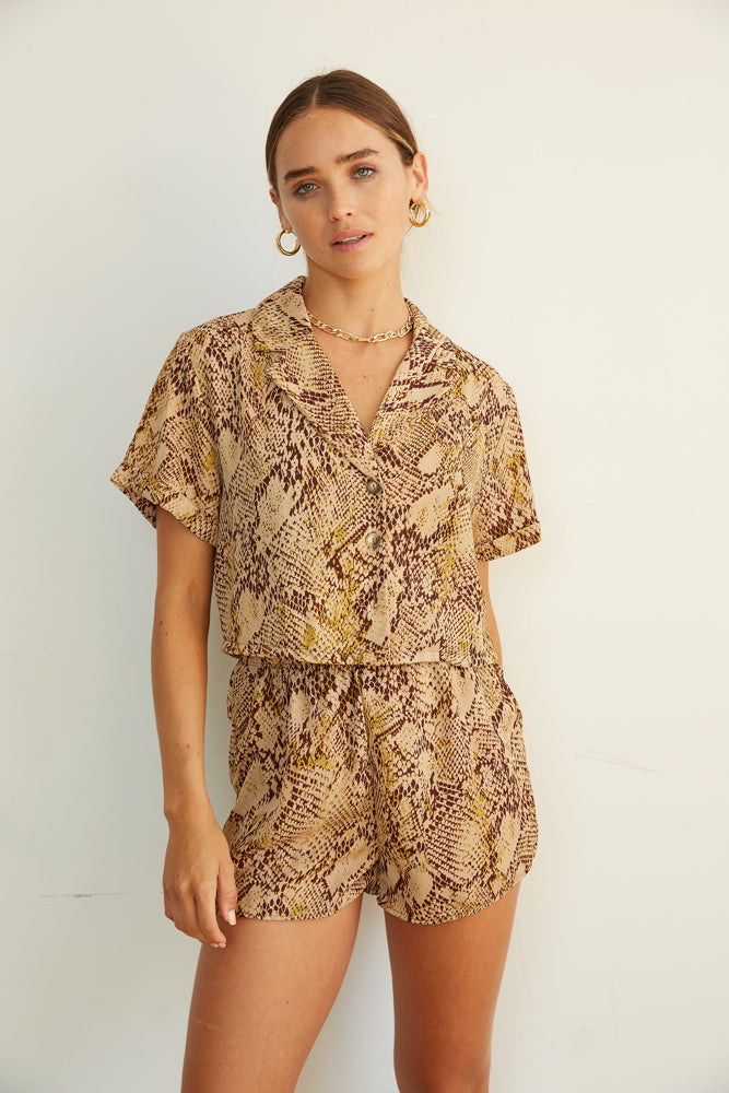 Snakeskin blouse with matching shorts.