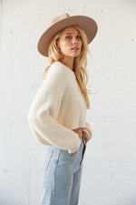 The side of this sweater shows off the long slouchy sleeves.