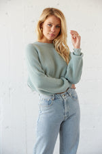 Blue cropped knit sweater with ribbed armholes.