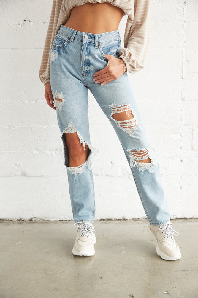 Super destroyed light wash jeans.