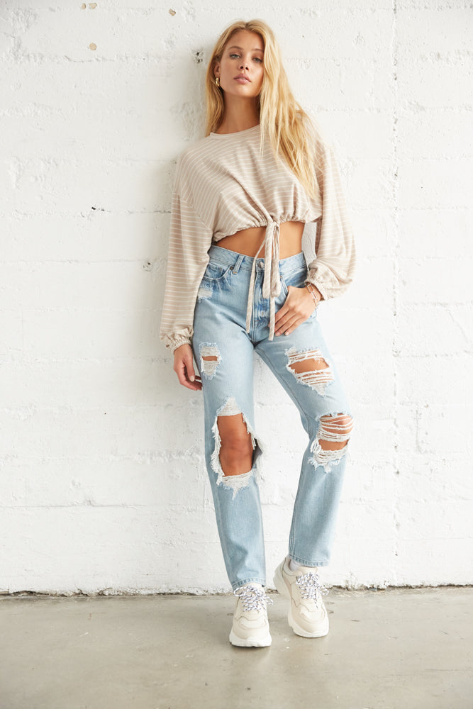 High waisted distressed mom jeans with soft knit crop top.