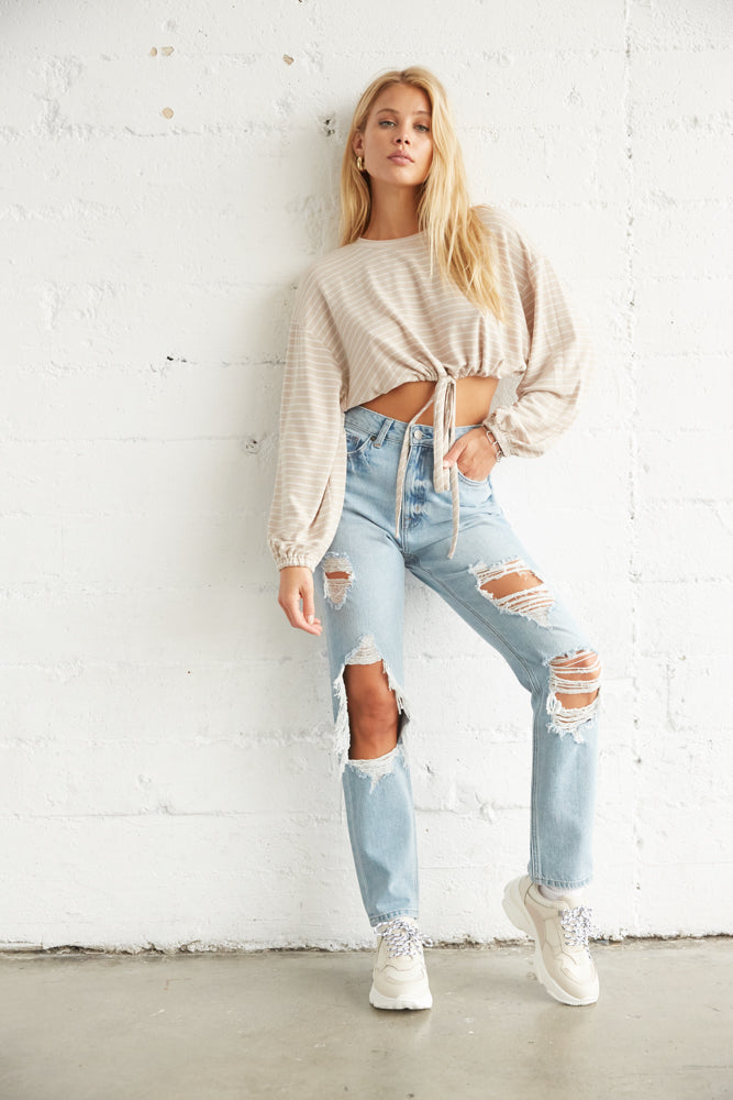 Relaxed crop top with distressed denim.
