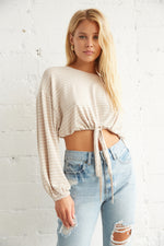 Beige and white striped crop top with adjustable drawstring tie.