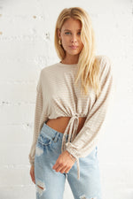 Beige and white striped crop top.