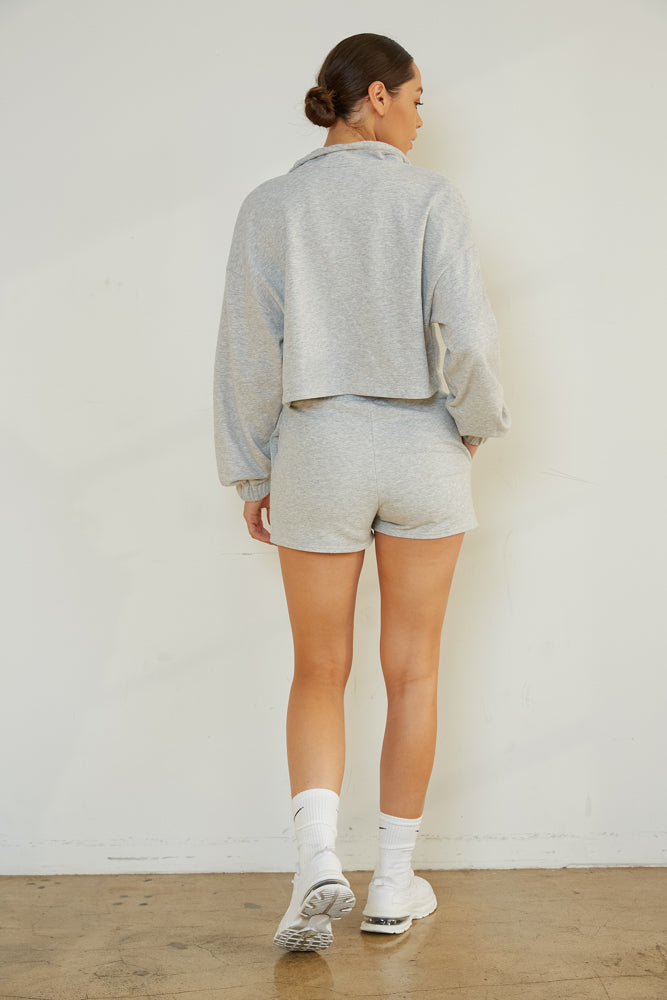 The back of this sweater is relaxed with long sleeves.