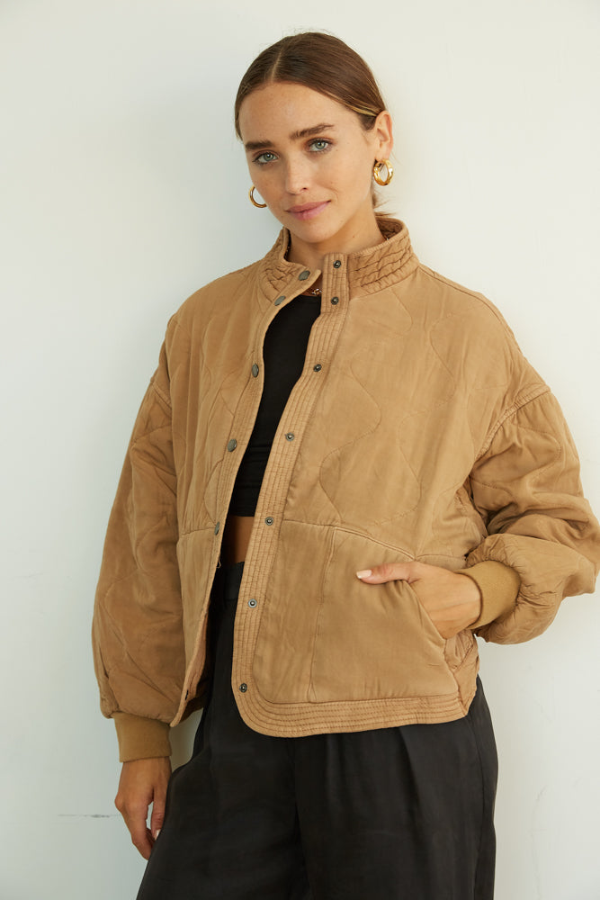 Brown quilted jacket.