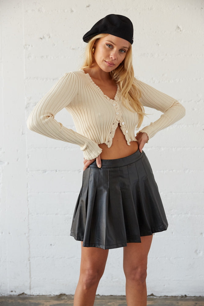 Ruffled sweater top with button up front.