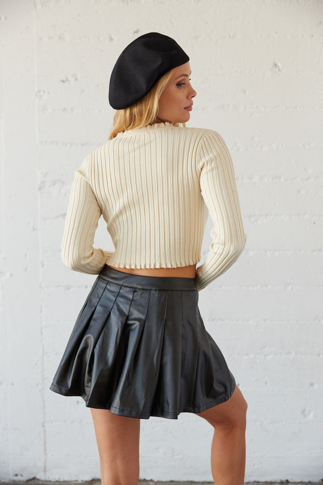 The back of this sweater top is cropped and ribbed for a flattering fit.