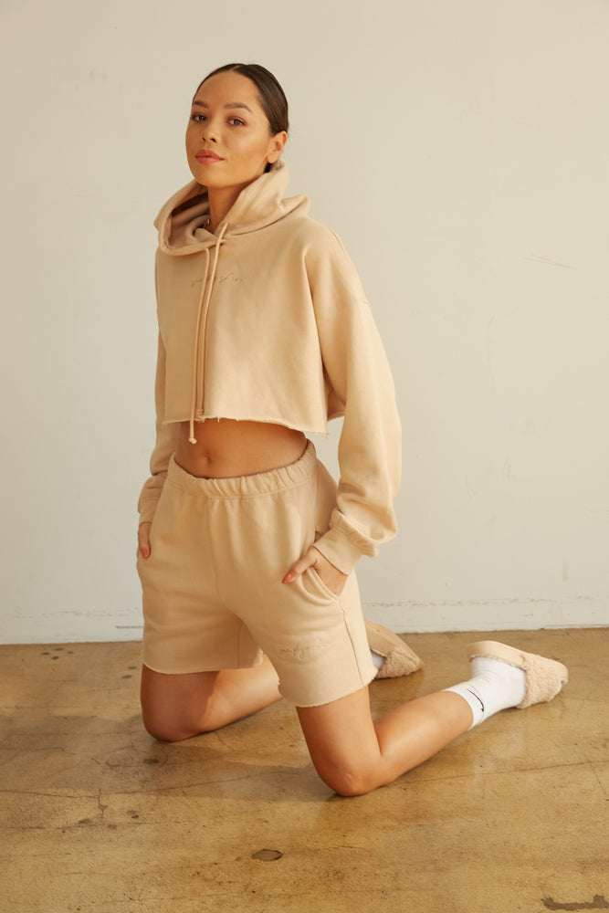 Cropped hoodie with raw hem.