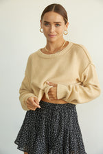 Boxy cropped knit sweater with exposed seams.
